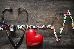The concept of medical care for heart disease. Cardiac rhythm in the chart of tabletsr stock image