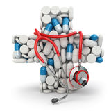 Concept of medicine. Cross from drugs and stethoscope. Royalty Free Stock Photography
