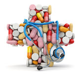 Concept of medicine. Cross from pills and stethoscope. Royalty Free Stock Photos
