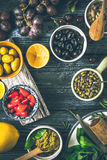 Concept of Mediterranean cuisine. Different fruit , herbs and appetizers on the  wooden table vertical Royalty Free Stock Photos