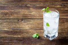 Concept menu for drinks - refreshing beverage with mint and ice in a glass on a wooden rustic table stock photos