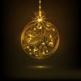 Concept of Merry Christmas and Happy New Year celebrations. Beautiful floral design decorated golden X-mas Ball hanging on brown background for Merry Christmas Royalty Free Stock Photos
