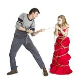 Concept of mesalliance and unequal match. Lady in red dress and pauper Royalty Free Stock Image