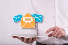 Concept of message. Message concept above a tablet held by a man in background royalty free stock photography