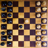 Concept met schaakstukken op een houten schaakraad Stock Fotografie