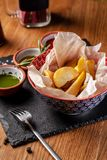 The concept of Mexican cuisine. Baked spicy potatoes with pepper, with different sauces, salsa, guacamole, chilli and shrimp. Background image. copy space stock image