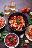 Concept of Mexican food.  Salsa, tortilla, beans, fajitas and te Stock Photos