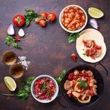 Concept of Mexican food.  Salsa, tortilla, beans, fajitas and te Stock Image