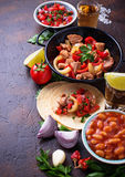 Concept of Mexican food.  Salsa, tortilla, beans, fajitas and te Royalty Free Stock Image