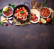 Concept of Mexican food.  Salsa, tortilla, beans, fajitas and te Royalty Free Stock Images
