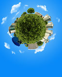 Concept miniature globe with building and forest Stock Photos