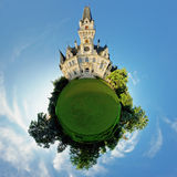 Concept miniature globe showing the castle. Royalty Free Stock Images