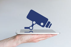 Concept of mobile surveillance solutions with smartphone or tablet. Stock Images