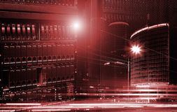 Concept of the modern digital world. server data center on the background of the skyscraper traffic. Red toning. Concept View of data technology against stock image