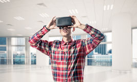 Concept of modern entertaining technologies with man wearing vir Royalty Free Stock Photo