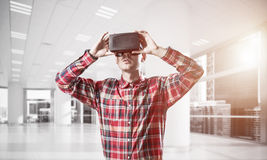 Concept of modern entertaining technologies with man wearing vir Stock Images