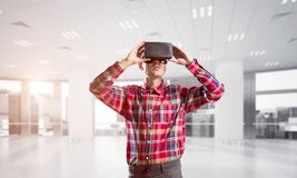 Concept of modern entertaining technologies with man wearing virtual reality mask Stock Image
