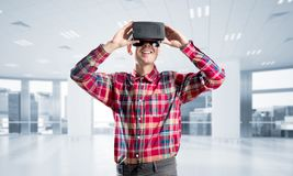 Concept of modern entertaining technologies with man wearing virtual reality mask Stock Photo