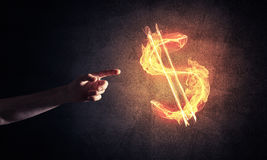 Concept of money making with dollar currency fire symbol on dark Royalty Free Stock Image