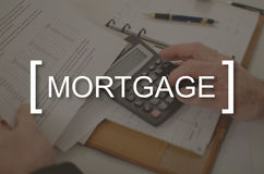 Concept of mortgage. Mortgage concept illustrated by a picture on background Stock Image