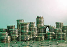 Concept of mortgage lending. Coins stacked as city Royalty Free Stock Images