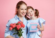 Concept of mother`s day. mom and child with flower on colored ba Stock Images