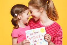 Concept of mother`s day. mom and child girl with postcard on col Stock Photography