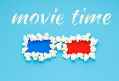 Concept of movie time with 3d glasses of popcorn. Royalty Free Stock Image