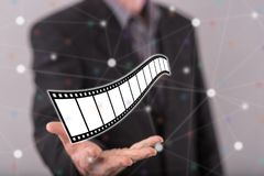Concept of movies, video and cinema. Movies, video and cinema concept above the hand of a man in background Royalty Free Stock Images