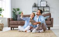 Concept of moving, buying home. married couple plans to repair and project apartment royalty free stock photos