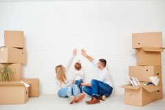 The concept of moving a family to a new home. Place for text on a white brick wall Stock Image