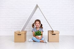 Concept of moving and housing. happy child girl with boxes royalty free stock photography