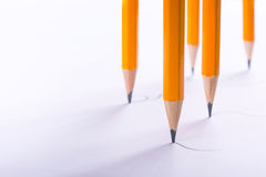 The concept of multitasking. Many pencils draw together. Empty space for text Royalty Free Stock Image