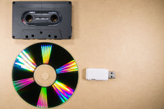Concept of music evolution. Musicassette, cd and usb support. Vintage and modern. Supports for music Stock Images