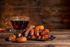 Concept of  muslim feast holy month Ramadan Kareem with dates an. D cup of tea Stock Photos