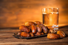 Concept of muslim feast holy month Ramadan Kareem in evening s. Cene with dates and glass of water royalty free stock photography