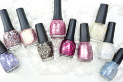 Concept with nail polishes. With glitter Royalty Free Stock Photo