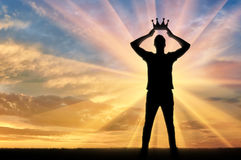 Concept of narcissism and selfishness man. Concept of narcissism and selfishness. Silhouette of a selfish and narcissistic man reconciling his own crown Royalty Free Stock Image