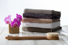 Dry brushing and traditional bath with Marseille soap and towels. Concept of natural dry brushing and traditional eco-friendly body care, bath, shower with stock images