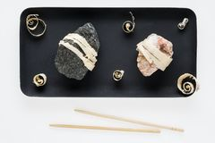 The concept of natural food. Abstract sushi made from stones and wood. Eco concept royalty free stock photo