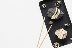 The concept of natural food. Abstract sushi made from stones and wood. Eco concept royalty free stock images