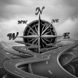 Concept Of Navigation. As a business compass symbol or moral compass icon in a group of roads and pathway routes as a journey metaphor for destination vision as Royalty Free Stock Photography
