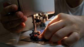Female hands sewing on a modern sewing machine stock video