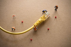 Concept of network troubleshoot supporter or administrator. Internet connection support team fixing LAN cable Stock Photo