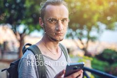 Concept of a new technology of face recognition on polygonal grid is constructed by points of IT security and protection. Biometric verification. Modern young royalty free stock image