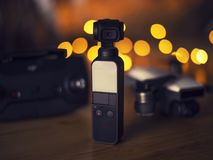 Concept of new technology Hi tech travel gadget and accessories. New gadget DJI Osmo Pocket the small camera combine with gimbal , concept of new technology stock image