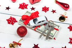 A car with keys and a stack of banknotes. The idea of a gift for royalty free stock photography