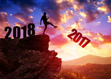Concept New Year 2018. Silhouette of man kicked to number 2017 Stock Photography