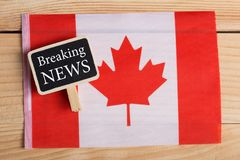 concept news feeds - Latest news, Canadian country's flag, blackboard with text Breaking News