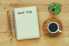 Concept NEXT TRIP message on notebook with pencil ,coffee cup an Stock Images